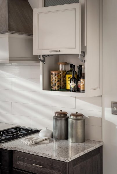 Medallion Cabinetry Wall With Vertical Lift Door
